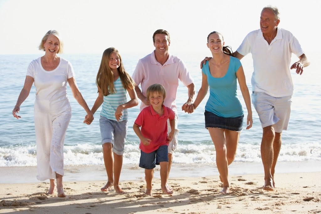 Multi-Generation Family running on beach