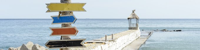 signposts on the beach tips medical insurance