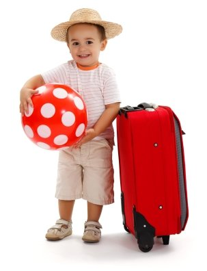 Kid withsuitcase, ready for journey