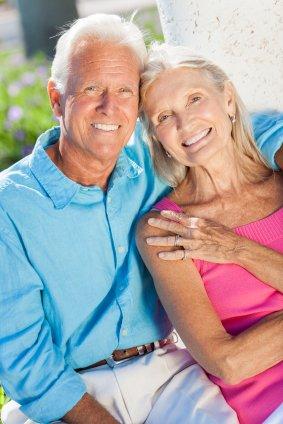 Happy Senior Couple Smiling Outside in Sunshine fall