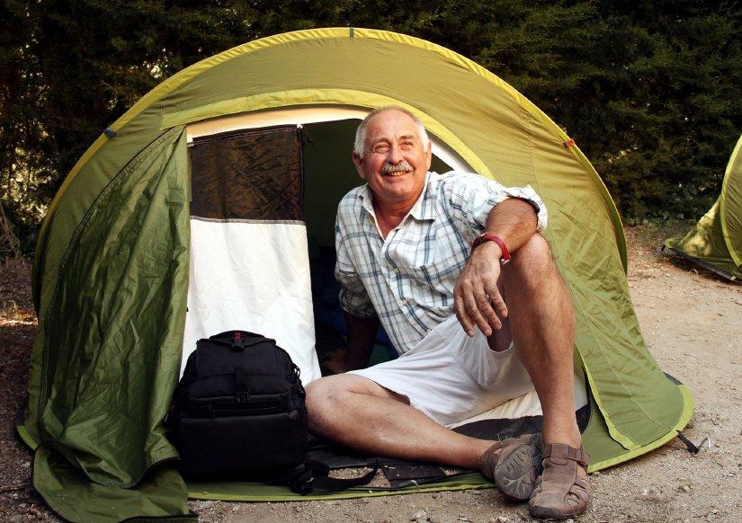 Senior on camping trip Backpacker Traveller