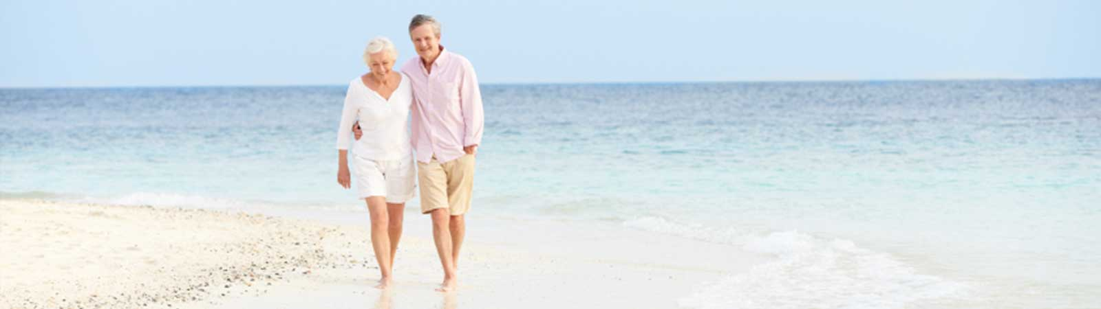 Couple walking on a exotic beach