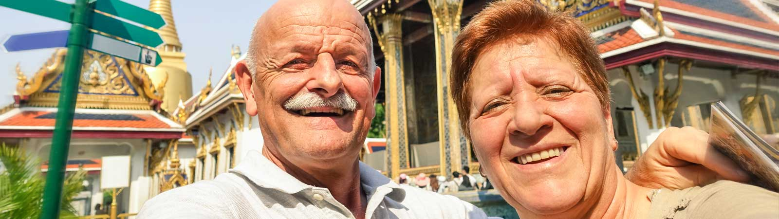 Senior couple smiling at the camera