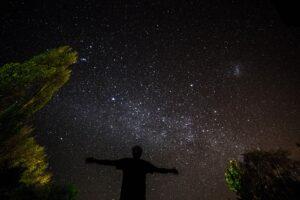 man under a dark sky